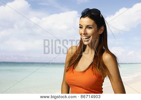 Happy girl enjoying summer on the beach.