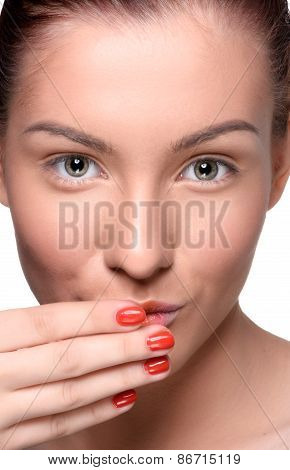 Beautiful young woman with colorful lips makeup and red nails