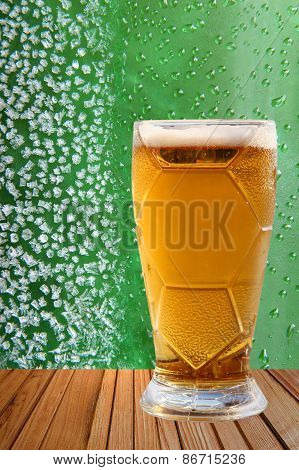Frost Beer Glass Against Of Ice Crystals And Drips Green Background.