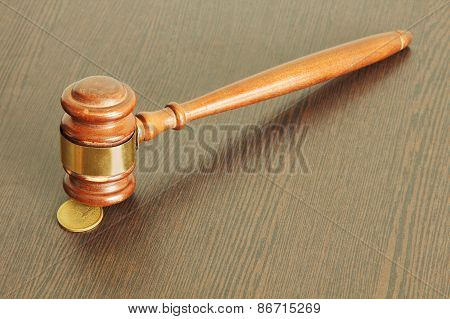 Auction Hammer Or Judge Gavel And One Dollar Coin On Wooden Tabl