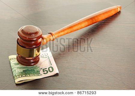 Judge Gavel And Fifty Dollars On Wooden Table.