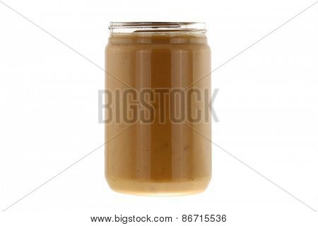 A Jar full of of creamy crunchy peanut butter isolated on white background