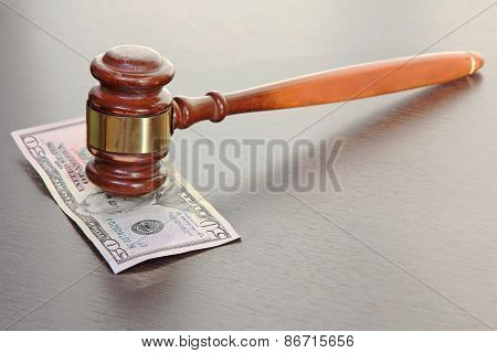 Judge Gavel And Fifty Dollars Banknote On Wooden Table.
