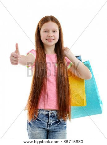 Beautiful little girl with shopping bags, isolated on white