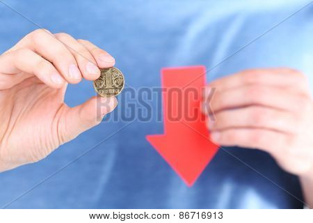 Man holding coin and red arrow close up