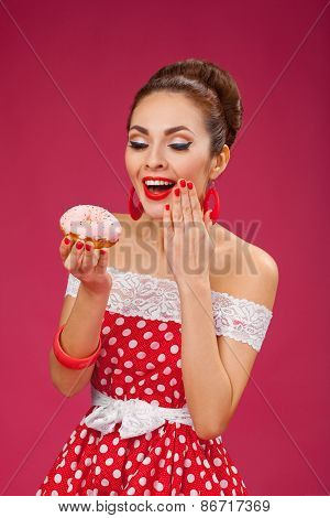 Happy Woman Holding Pink Doughnut. Pin-up retro style.