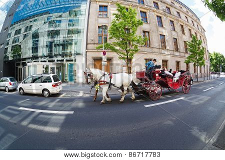 Tourists On A Carriage Ride