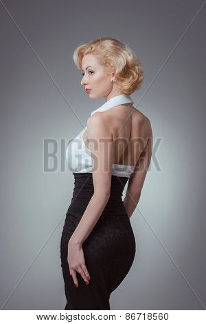 Pin-up girl young and beautiful woman portrait on gray background