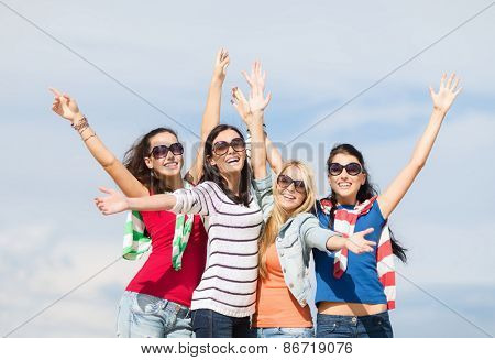 summer, holidays, vacation and people concept - beautiful teenage girls or young women having fun on beach