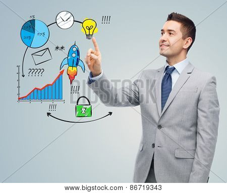 business, people, development and startup concept - happy businessman in suit touching business scheme