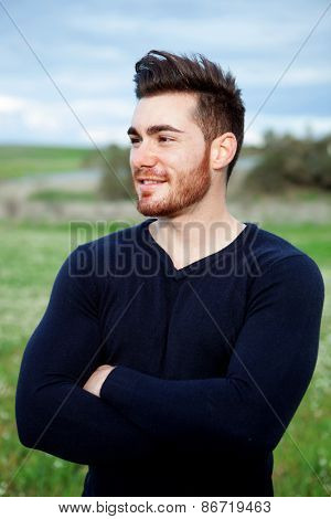 Cool handsome guy with beard smiling