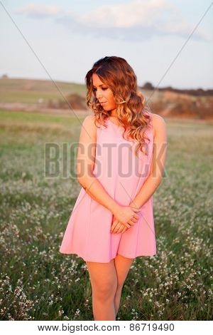 Pretty cool woman dressed in pink with a beautiful smile