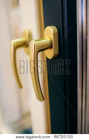 Window handle of a gold color.