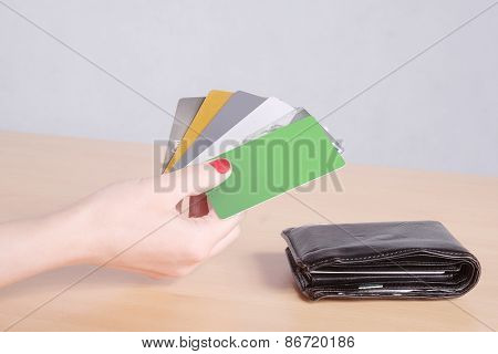 Woman hand holding pack of plastic credit card.