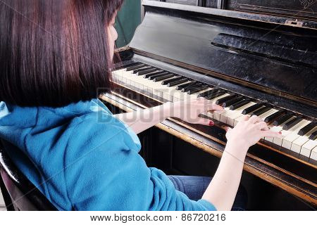 Piano with players female hands