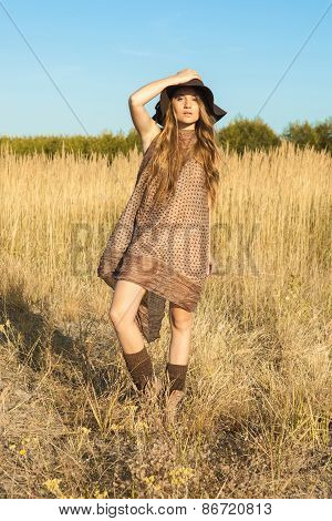 Beautiful Model Wandering Through Meadow At Midday