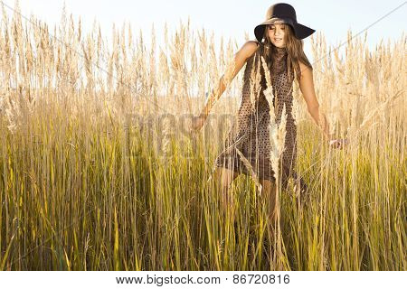 Beautiful Model Wandering Through Meadow Wilds At Midday