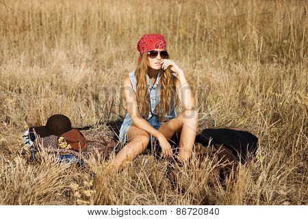 Beautiful Young Hippy Girl Sitting In Open Field At Midday