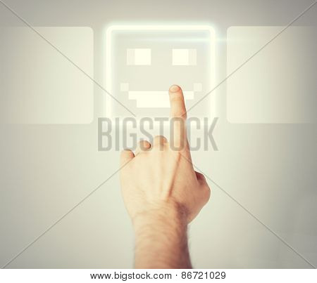 male hand touching virtual screen with smile button