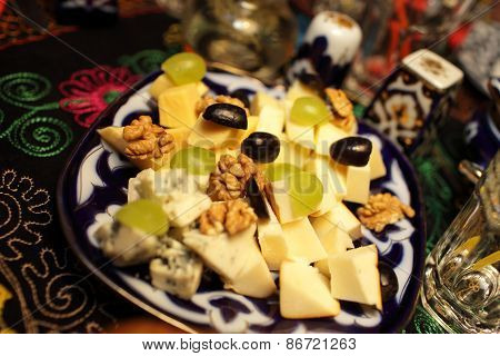 Plate With Sliced Cheeses