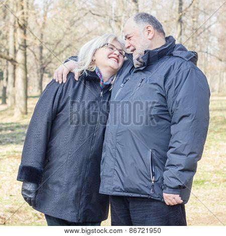 Happy Elderly Senior Couple Emracing