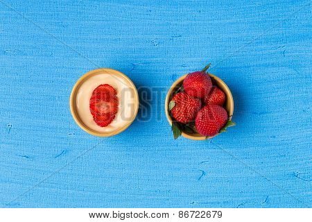 Pudding And Strawberries In Bowls On Blue Background