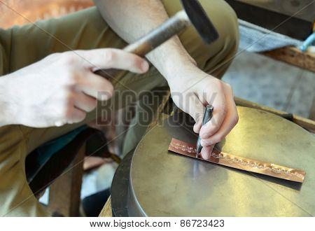 Craftsman makes copper bracelet