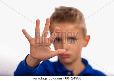 Boy Making A Stop Gesture With His Hand