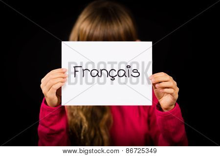 Child Holding Sign With French Word Francais - French
