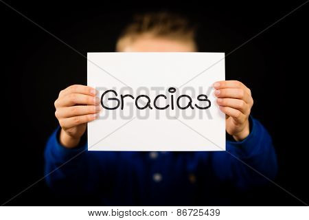 Child Holding Sign With Spanish Word Gracias - Thank You