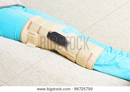 Woman's leg in knee cages for stabilization and support