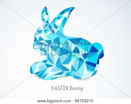 Shiny blue crystal rabbit for Happy Easter celebration on shiny grey background.