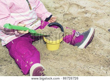 girl playing on sand beach