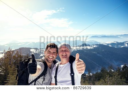 Hikers With Thumb Up