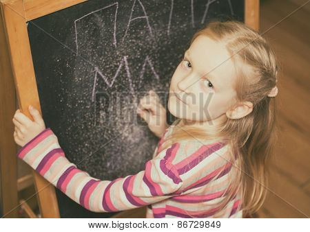 Girl Draws On An Easel