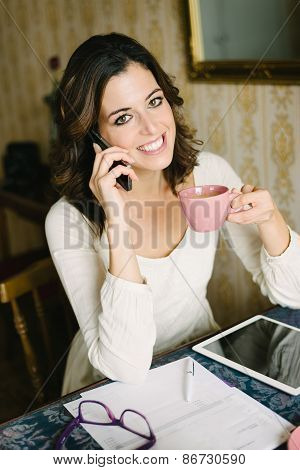 Cheerful Woman With Smartphone Working At Home