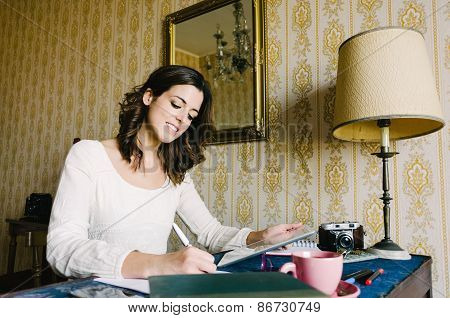 Woman With Digital Tablet Working At Home