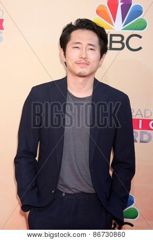LOS ANGELES - MAR 29:  Steven Yeun at the 2015 iHeartRadio Music Awards at the Shrine Auditorium on March 29, 2015 in Los Angeles, CA