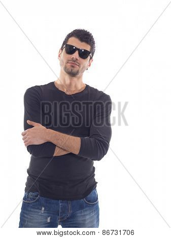 Casual man in Jeans and sunglasses posing over white background