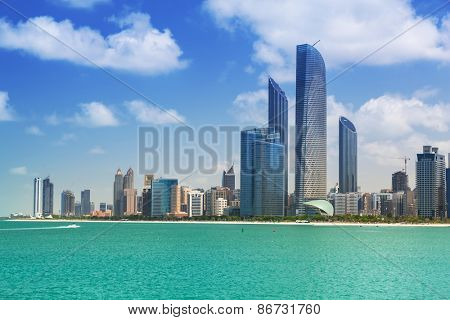 ABU DHABI, UAE - MARCH 27, 2014: Cityscape of Abu Dhabi with skyscrapers, UAE. Abu Dhabi is the capital and the second most populous city in the United Arab Emirates with around 1 million people.