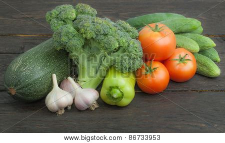 Raw organic vegetables on the wooden table