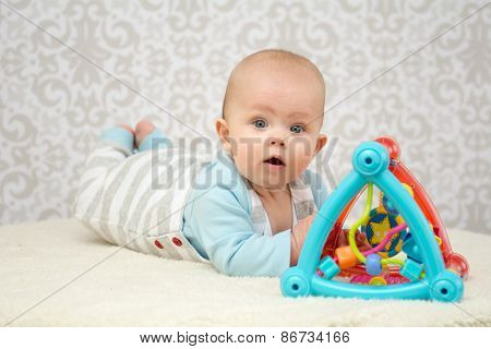 Blue Eyes Baby Playing With Toy