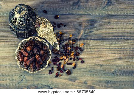 Still Life With Vintage Orintal Lantern, Raisins And Dates