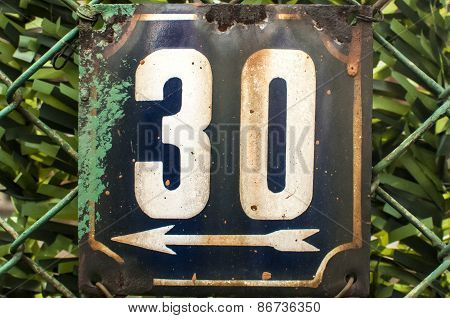 Weathered enameled plate number 30
