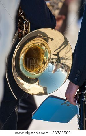 Man Plays The Trombone During A Religious Cerimony