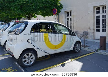 LA ROCHELLE, FRANCE - JUNE 24, 2013: Electric car Yelomobile recharging at the charging station. Since 1999, the 24/7 access to electric cars is provided using 13 stations in the city and suburbs