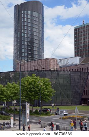 DORTMUND, GERMANY - JUNE 22, 2013: People near the modern building of City and State library. After the opening of new building, the use of library increased by 60%