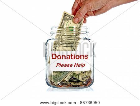 Putting Money Into Donation Jar