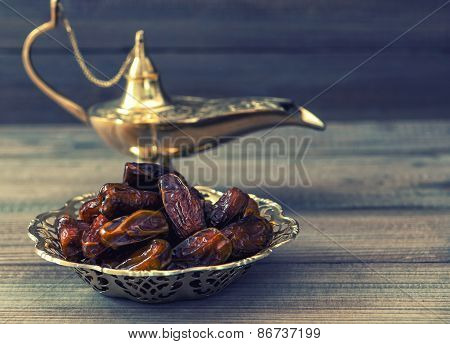Dates And Golden Arabian Lamp On Wooden Background. Oriental Food