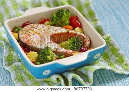 Baked red salmon with vegetables